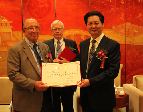 Host University President Lou Yuangong (right)  Keynote Speakers J. Heckman (middle) & D. Mortensen (left)